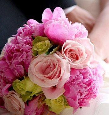 Hand tied bouquet, featuring bright pink peonies with Katharina and Jade roses