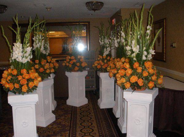 Gladiola with orange roses
