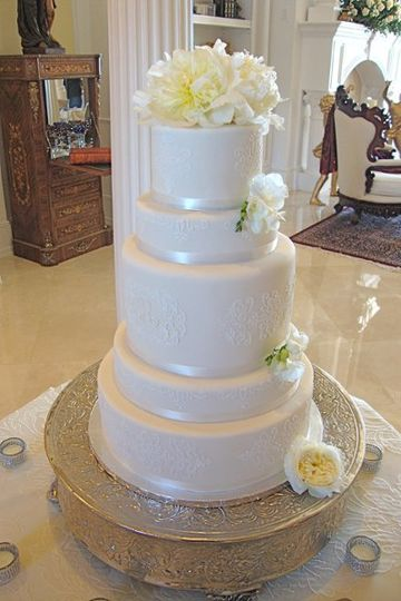 Simply Elegant 5 tier Wedding Cake with white satin ribbon and live flowers.