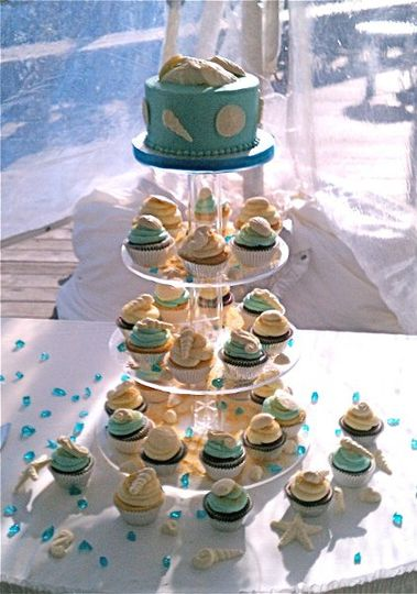 """Blue fondant covered 6"""" beach cake with large white chocolate shells as accents.  Blue and ivory..."""