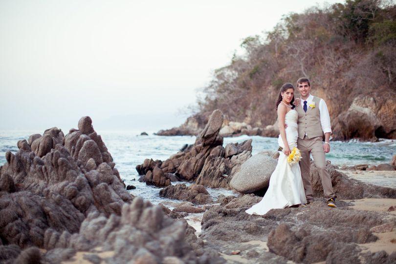 Dramatic image of couple on rocks