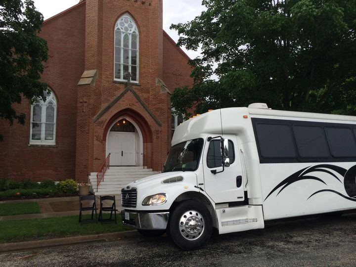 land yacht in front of church