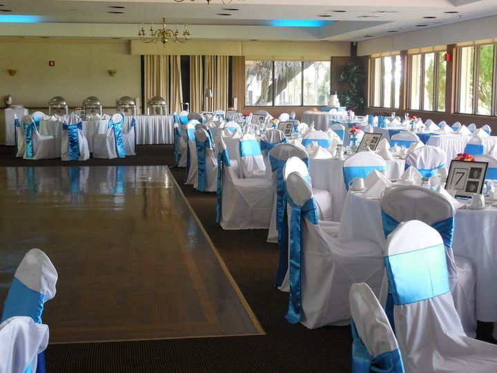 White table setup with blue bow