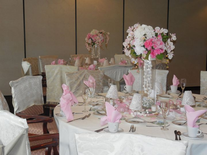 Pink and white table setup