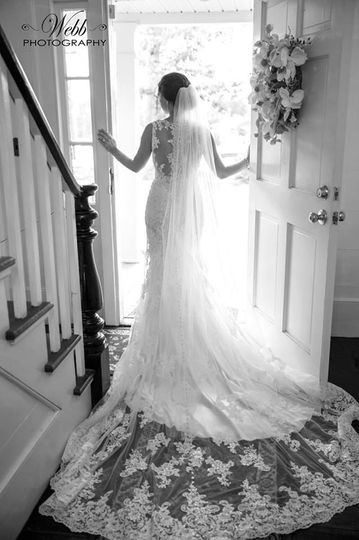 Love the open door shot with Bride gazing out.  Shows the back of her beautiful gown.