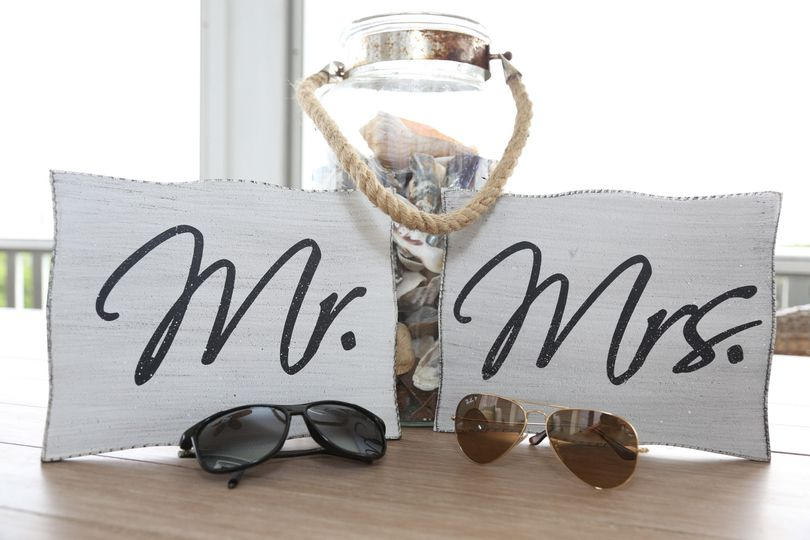 A cute way to display the announcement of Mr. and Mrs at the Beach.