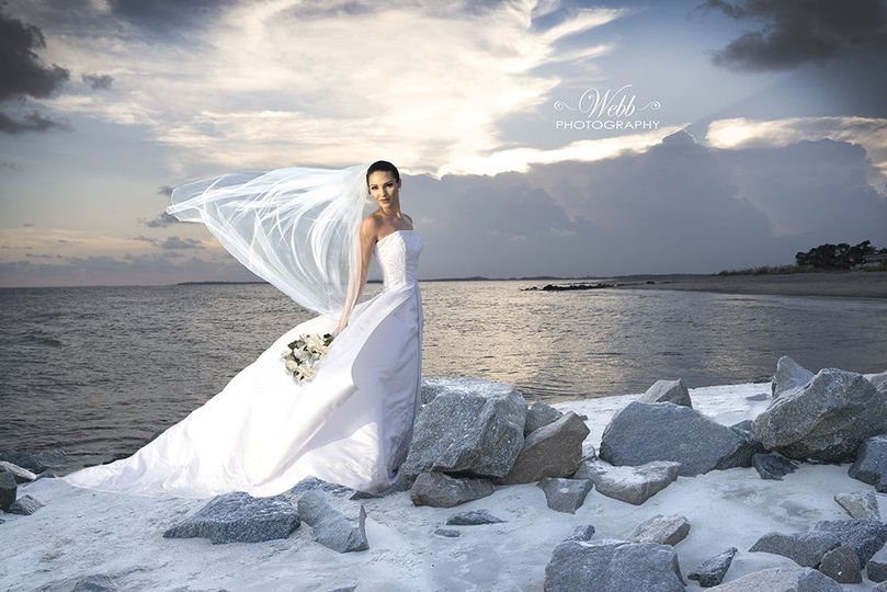 Beautiful Bridal at Edisto Beach SC.  Love the setting on rocks backed by fabulous sky and ocean.