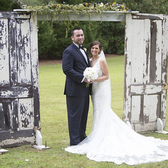 The Vintage Doors are a great gazebo for the setting of this Wedding