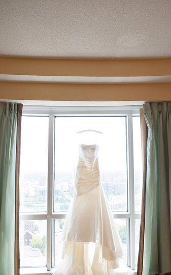 downtown Kansas City hotel skyline wedding dress in window