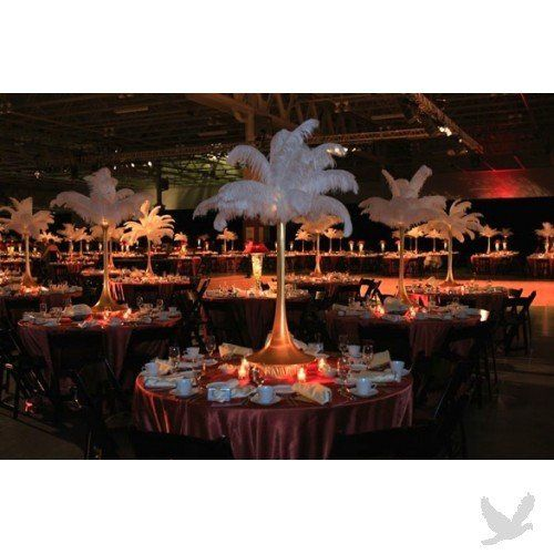"""Tall centerpieces like these help when you have a large room. The 32"""" trumpet vases are a great..."""