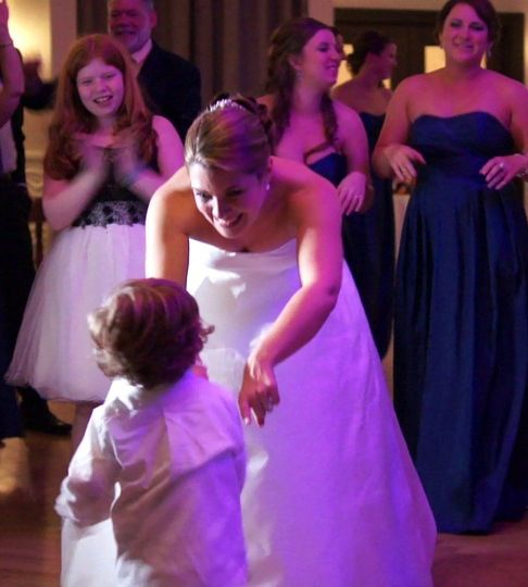 Bride dancing with the kid