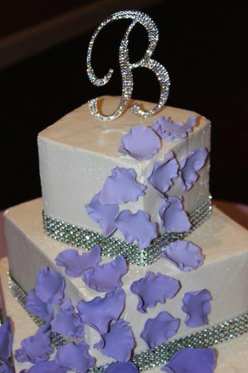 Violet petals on wedding cake