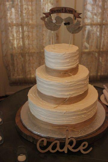 3-tier wedding cake with lovebird cutouts