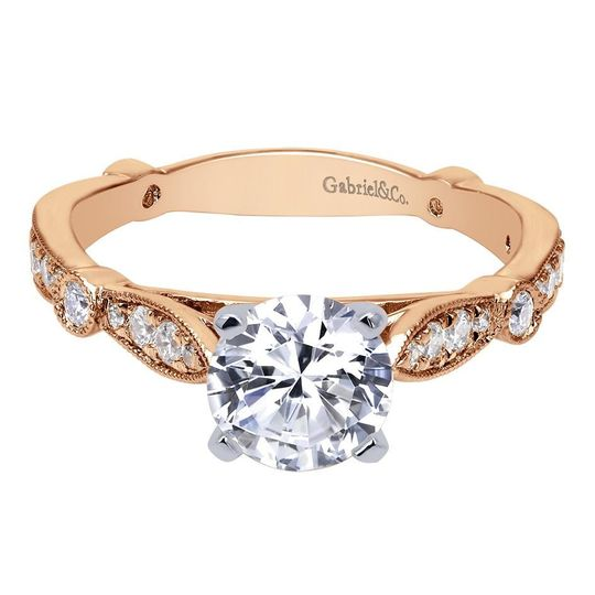 14K rose gold vintage style diamond engagement ring.  Designed by Gabriel & CO.