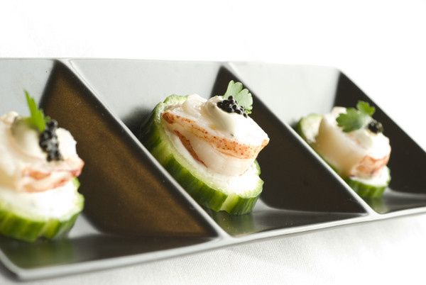Cucumber Rounds layered with Lobster Medallions, Lemon-Tarragon Creme Fraiche and Caviar