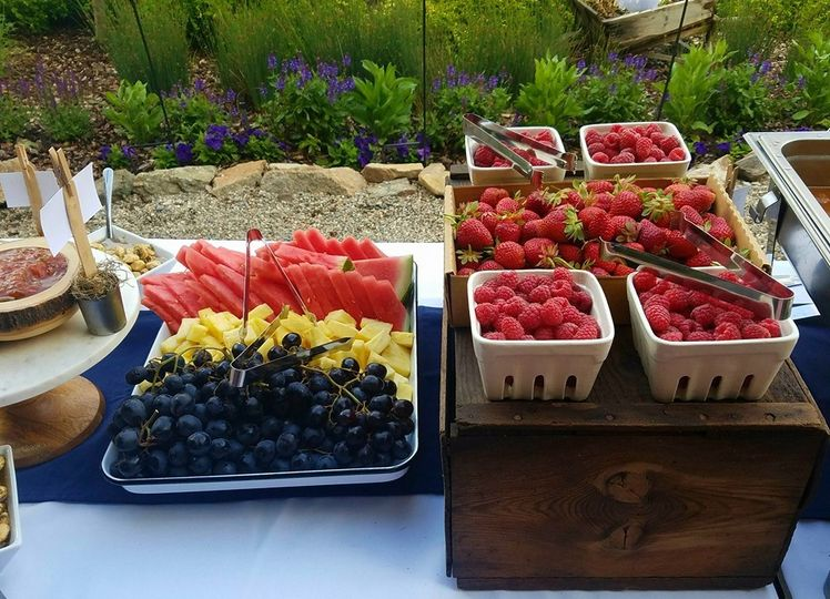 A fruit display on a buffet,