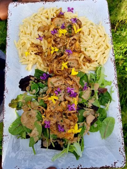 Local pike topped with homegrown oyster mushrooms, chives, forsythia and lilac petals.