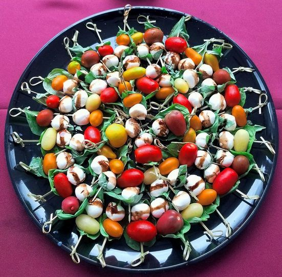 Beautiful tomatoes make these caprese skewers.