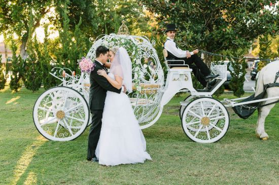 Couple and their bridal carriage