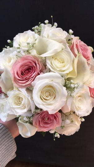 White roses, light pink roses, white cala lilies, babies breath