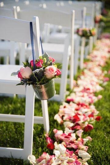 Petals on wedding aisle