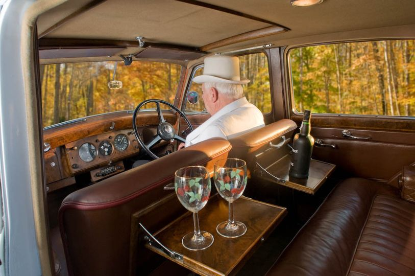 Italian walnut picnic tables flip out of the front seats in the leather interior of the 1952...