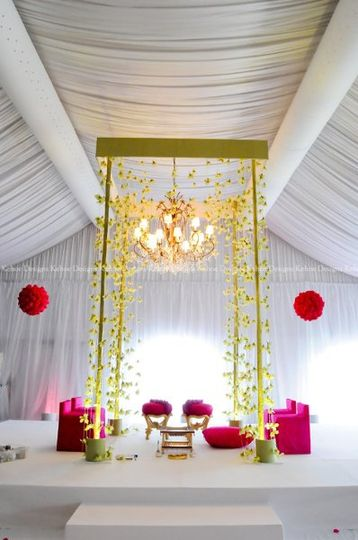 A towering ceremonial mandap dramatically showcases hundreds of floating green orchids, all of which...