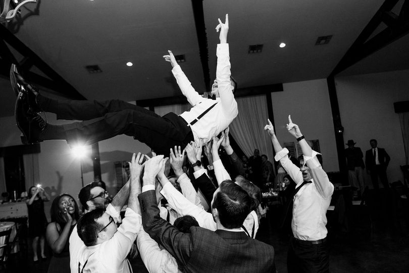 Throwing the groom in the air!