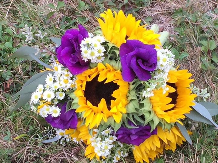 Sunflowers and purple roses