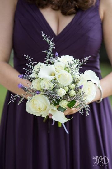 Purple dress against white roses