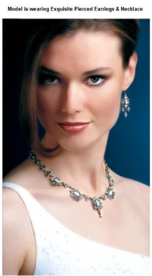 Fit for a princess, this gorgeous heirloom-quality ensemble features white cats-eye stones accented...