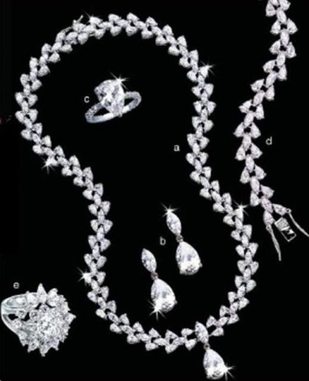 the glittering ball separates in half with a gentle pull and snaps back to close.  Exquisite...
