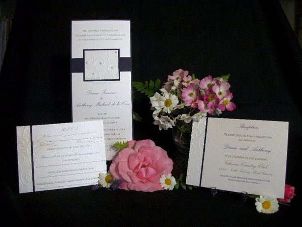 Elegant champagne and deep purple invitation with embossed embellishment and pearls