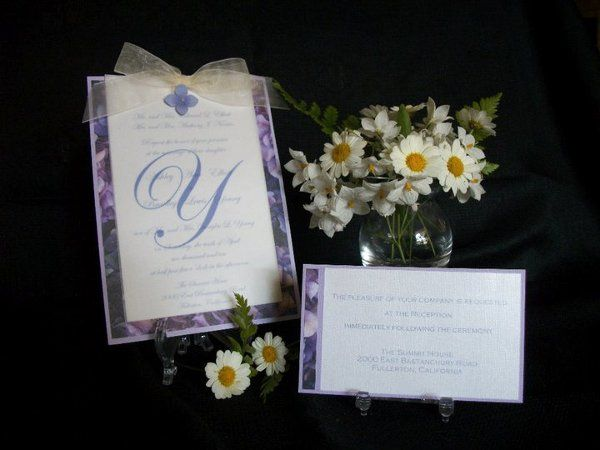 Garden purple floral panel invitation with monogramed vellum overlay.  Blossom and ribbon accent