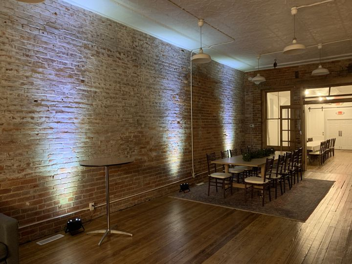 Exposed brick with lighting