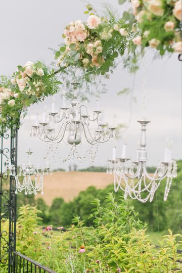 An arbor of all the beautiful blooms and crystal chandeliers...a dreamy backdrop for the ceremony.