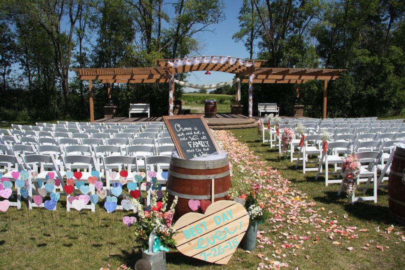 A whimsical outdoor ceremony setup