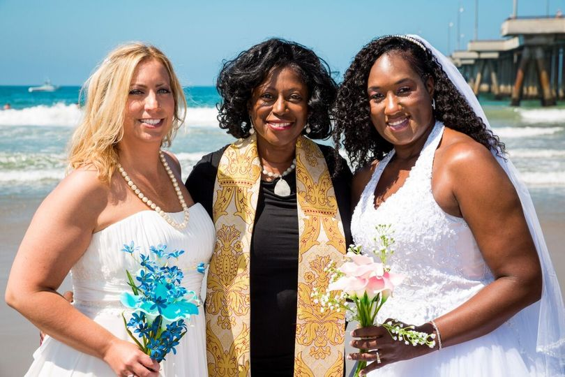 Officiant with the brides