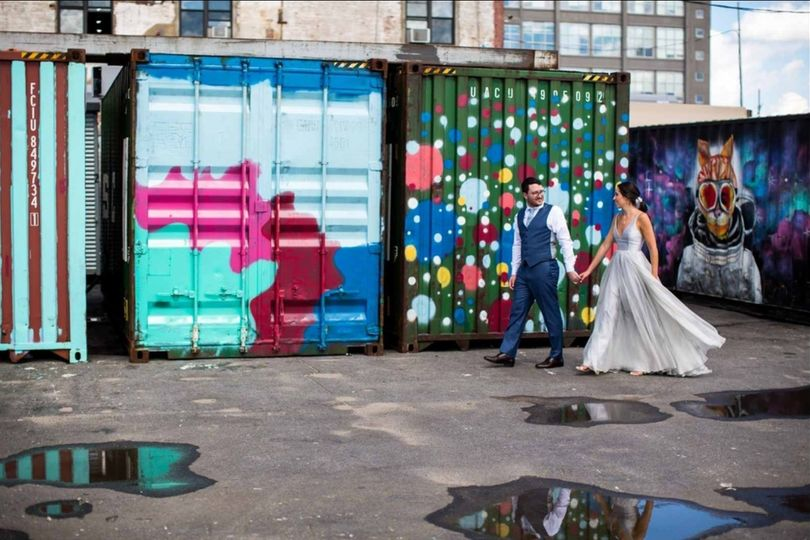Newlyweds by the container vans