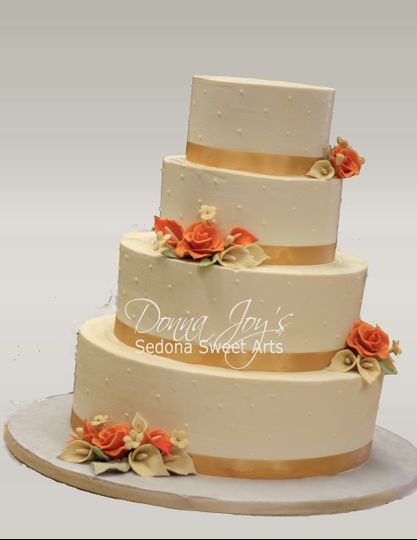Classic Buttercream Wedding Cake with hand sculpted sugar flowers by Pastry Chef Donna Joy