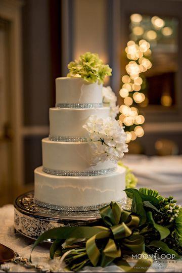 White wedding cake with minimal flowers