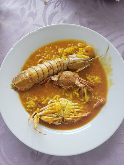 Brothy rice with seafood