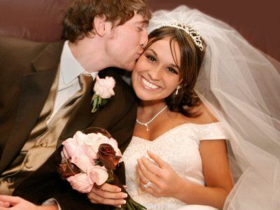 A happy Bride & Groom after a wonderfully hosted ceremony & reception by FANTASIA Sight & Sound