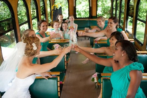 Bride and her bridesmaids inside a tram