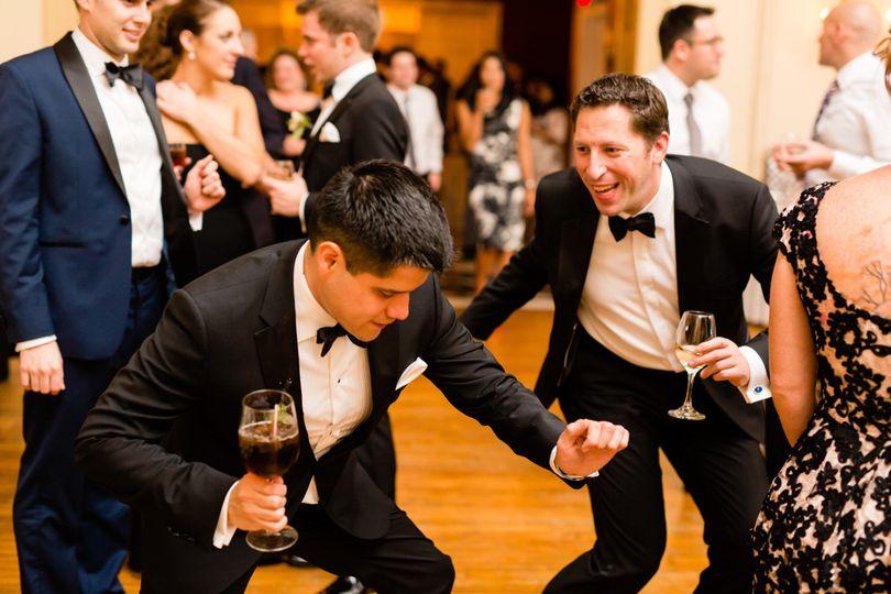 Wedding party with men dancing