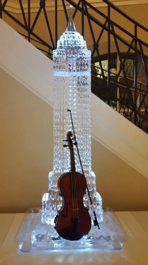 The violin against a city sculpture