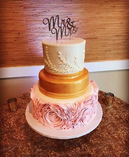 3-tier cake with gold and floral tiers