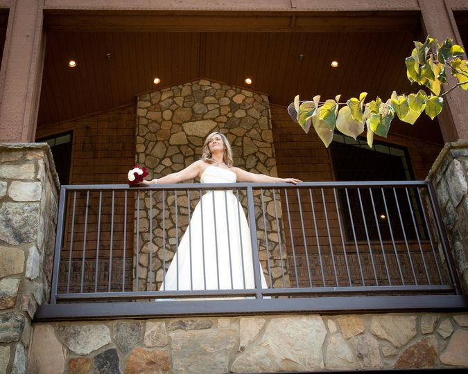 A beautiful bride looking out from the balcony
