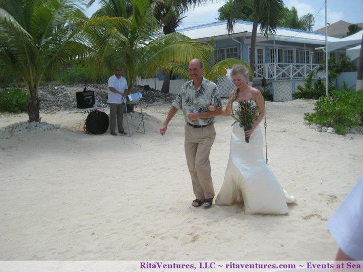 Beautiful photo where you can see a great view of the bride and father walking down the aisle with...