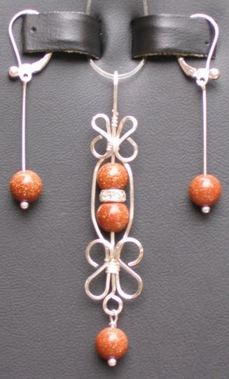A filigree Pendant Set, handcrafted Sterling Silver around 15 stone choices.  Makes a great gift for...